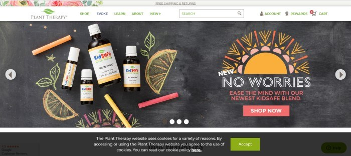 This screenshot of the home page for Plant Therapy shows an assortment of essential oil bottles with Kidsafe labels lying on a chalk board with colored chalk and some chalk sketches of lemon slices, along with an ad for the Kidsafe line of essential oils.