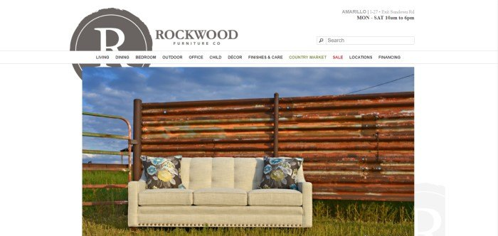 This screenshot of the home page for Rockwood Furniture shows a beige sofa with throw pillows on either end sitting on the grass outside in front of a log wall.