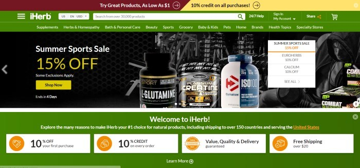 This screenshot of iHerb's home page shows a green background with mostly white lettering, and there is a photograph with a dark background and several bottles of iHerb supplements, along with a 15% summer sales pitch.