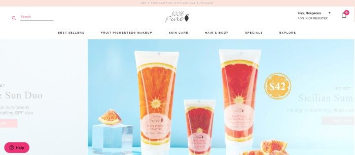 This screenshot of the home page for 100% Pure shows a set of Blood Oranges skincare products, which come in white tubes with a photo of a blood orange wrapping around it, and the products are set against a light blue background with blood orange slices and a cube of glass or ice.