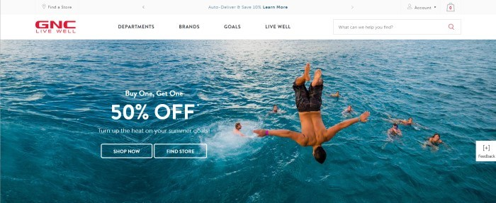 This screenshot of the home page for GNC shows a man flipping into the ocean while around seven other people who are already in the water watch and smile, along with an advertisement in white text for a 50% off summer sale.