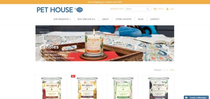 This screenshot of the home page for One Fur All shows a lit Pet House candle on a red cloth in the center of a wooden tray on a table.
