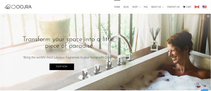 This screenshot of the home page for Oojrashows a woman enjoying a bubble bath.