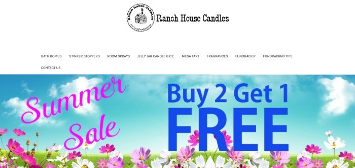 This screenshot oft the home page for Ranch House Candle Co. shows a blue sky over a field of flowers behind a buy-2, get-1-free summer sale announcement.