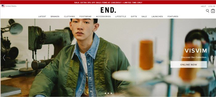 This screenshot of the homepage for End shows a young man in a white and yellow tee shirt, blue denim jacket, and olive green rain jacket sitting in a room of antique sewing equipment.