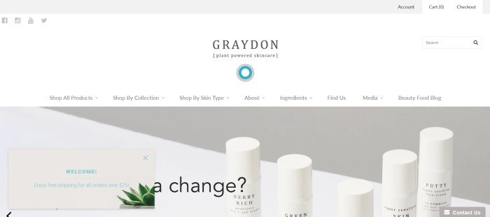 This screenshot of the home page for Graydon has a white background and a photo of a white table with four white bottles of skincare products.