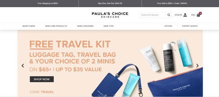 This screenshot of the home page for Paula's Choice Skincare has a white background and a beige text box with dark peach lettering that introduces a free travel kit for skin care products, along with a photo of three bottles of skin care products and a blue leather-look bag to put them in.