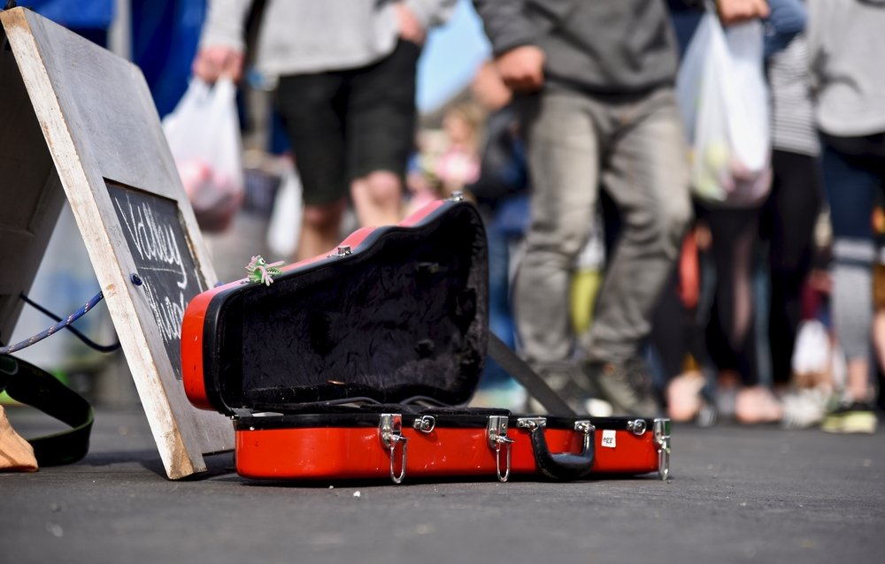 An open violin case, collecting money for buskers