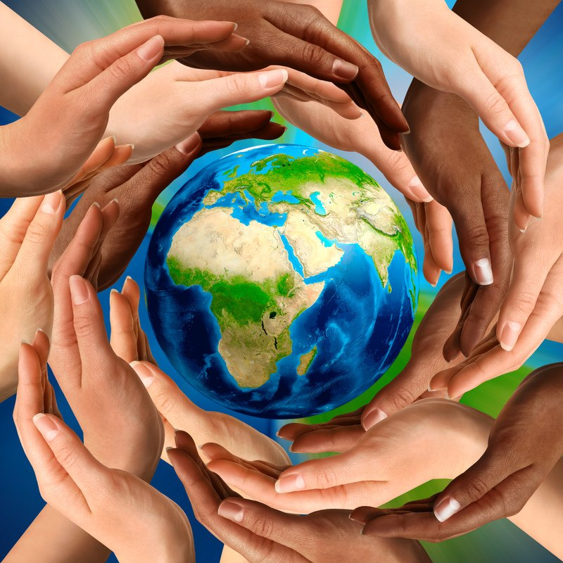 This photo shows many hands around the outside of the Earth, representing the best environmental affiliate programs.