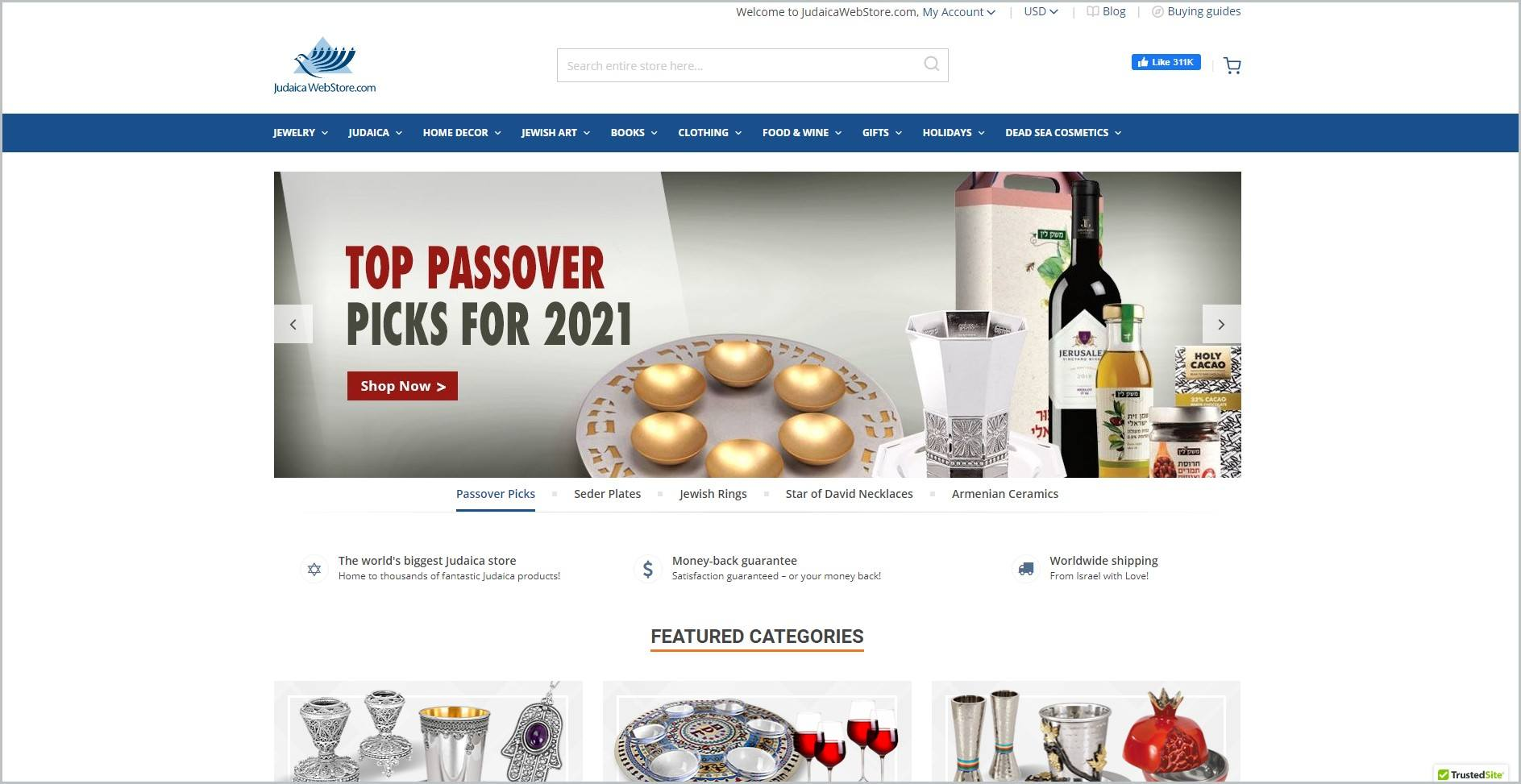 screenshot of Judaica WebStore homepage, with white header bearing the website's name and search bar, under that is a blue bar with the navigation menu, it also showcases images of the website's products