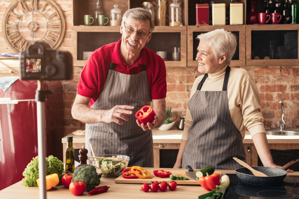 older couple with video food blog