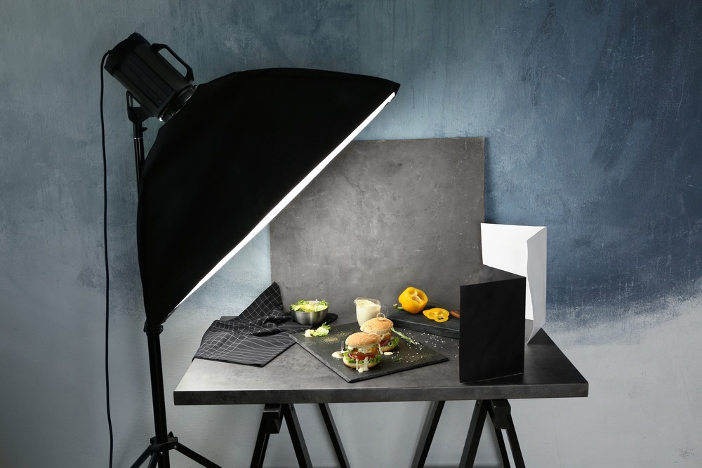 professional lighting with studio photographing food plated on slate