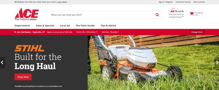 This screenshot of the home page for Ace Hardware has a red information bar below a white navigation bar and above a photo of a Stihl lawn mower on green grass, next to a section with a black background orange and white text, and a red call-to-action button for shopping for Stihl products.
