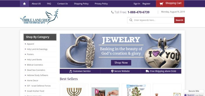 This screenshot of the home page for the Bibleland Shop has a white background with dark blue text and a large photo showing silver jewelry against a blue background.