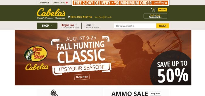 This screenshot of the home page for Cabela's shows a dark green header with gold and green text above an orange-filtered photo of a bow hunter, near an advertisement in white text announcing a fall hunting classic and an ammo sale.