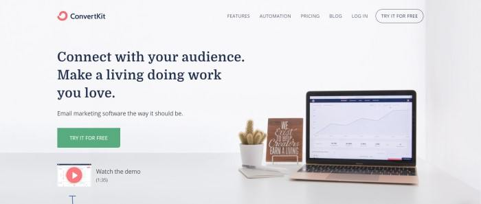 This screenshot of the home page for ConvertKit has a gray background, black text, and a photo of an open laptop on a desk next to a potted cactus.
