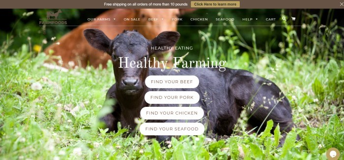 This screenshot of the home page for Farm Foods shows a black cow lying in a green field, behind white bubble invitations for customers to discover farms where beef, pork, chicken, and seafood are sourced.