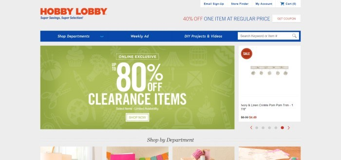 This screenshot of the home page of Hobby Lobby has a blue navigation bar, a white background, and a large green section advertising an 80% off sale, above a row of smaller photos of trending products.