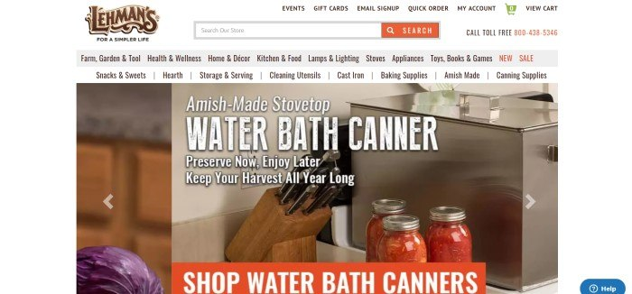 This screenshot of the home page for Lehman's has a white background with a large photo of a water bath canner, three bottles of canned tomatoes, and a set of knives, behind white text announcing an Amish-made stovetop water bath canner.