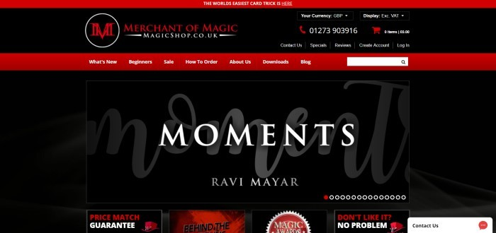 This screenshot of the home page for Merchant of Magic shows a distinctive web page with a black background, red header and accents, and white text that announces 'Moments' by Ravi Mayar.