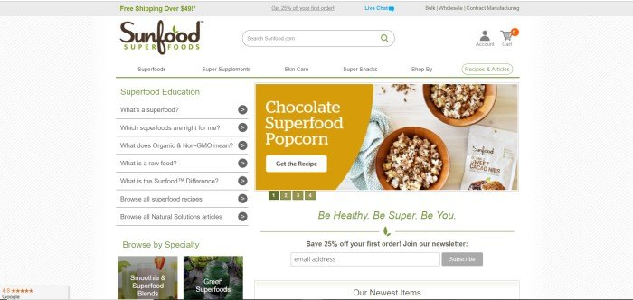 This screenshot of the home page for Sunfood has a white background with gray diagonal stripes, a question and answer section on the left side of the page, and an advertisement for chocolate superfood popcorn on the right side of the page, including an overhead photo of two bowls of chocolate-drizzled popcorn.