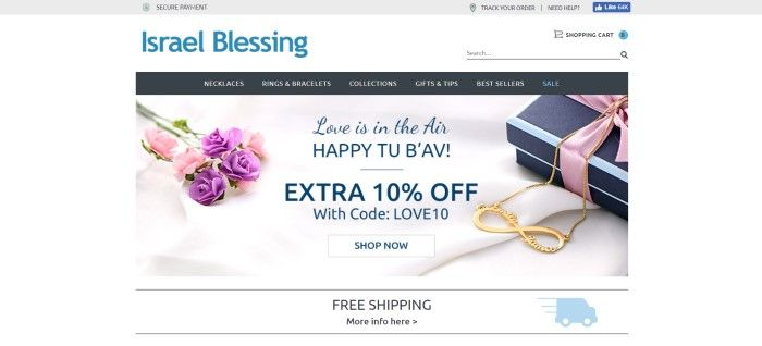This screenshot of the home page for Israel Blessing has a white background, a black header, and a photo with a white fabric background, purple and pink flowers, a blue gift box with a purple ribbon, and an golden personalized necklace.