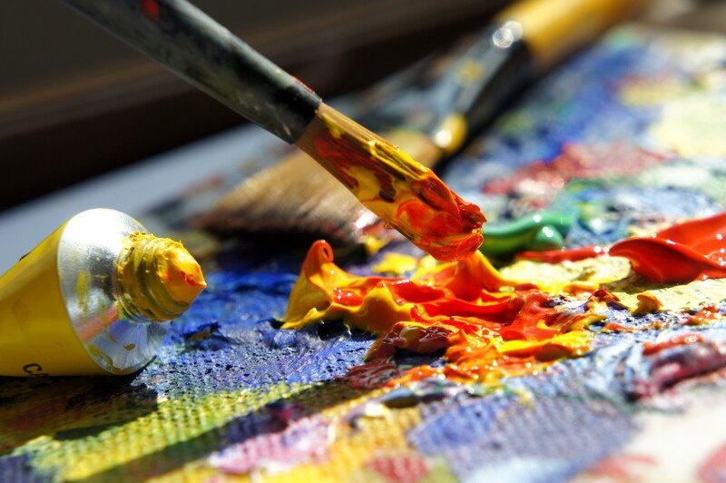 mix of red and orange oil paints with a fine-tipped paint brush