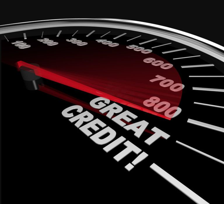 "This photo shows a black credit score gauge, with the needle pointing far to the right where some white text reads ""Great credit,"" representing the best credit score affiliate programs."