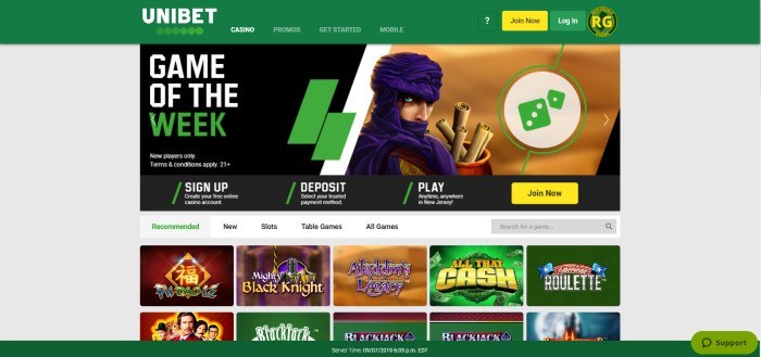 This screenshot of the home page for Unibet has a gray background with a forest green header and footer, along with an image of Aladdin's Legacy as the game of the week and several images of other recommended games below it.