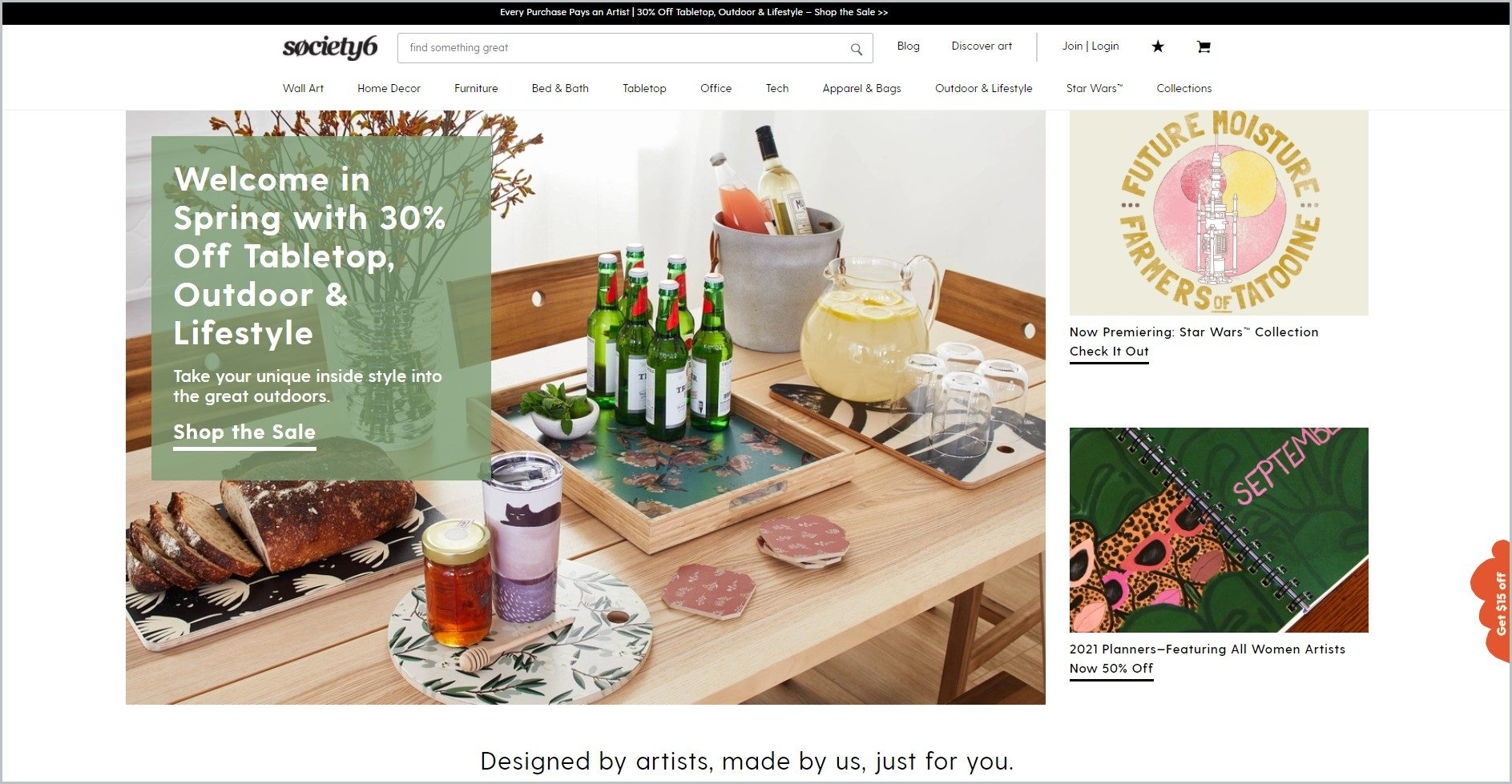 screenshot of Society6 homepage with dark grey announcement bar, white header bearing the website's name and main navigation menu, showcasing some of their products