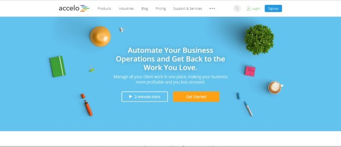 This screenshot of the home page for Accelo has a light blue background with a scattering of office supplies across it and an invitation in white lettering to use this company to automate operations and manage client work more smoothly.