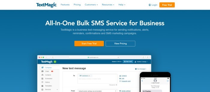 This screenshot of the home page for TextMagic has a white navigation bar above a plain blue section with white text announcing TextMagic as an all-in-one bulk SMS service for business, along with an orange call-to-action button and an image of TextMagic software open on laptop and a mobile device.