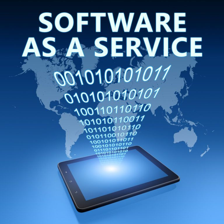 "This image has a blue background with lighter blue sections that show the shape of Earth's major continents, behind a black tablet with a blue lit screen that's projecting digital code and the words ""Software as a Service"" in front of the continents, representing the best SAAS affiliate programs."
