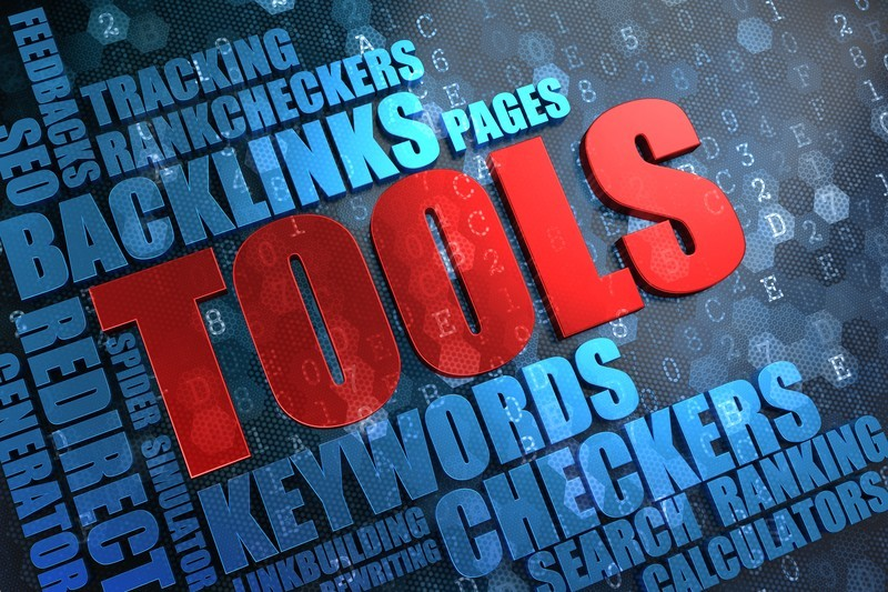This images shows a dark blue background with the word 'Tools' in red, surrounded by light blue words such as 'Backlinks' and 'Keywords', representing the best SEO tools affiliate programs.