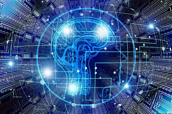 A graphic showing a blue brain in front of data