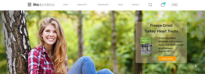 Lifes Abundance Website Screenshot showing a young woman in a forest and a product image for turkey heart treats