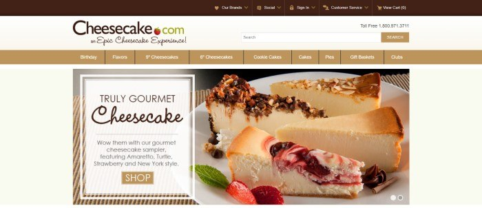 This screenshot of the home page for Cheesecake.com has a beige background, a tan navigation bar with white text, and a large photo of several slices of different types of cheesecake, next to an advertisement box in white with black text inviting shoppers to try the gourmet cheesecake sampler.