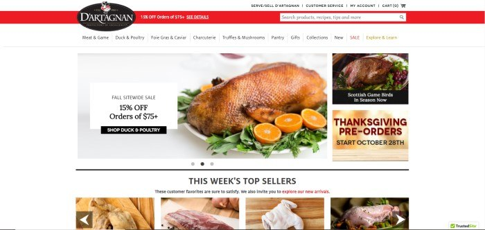 This screenshot of the home page for D'Artagnan shows a red header announcing a 15% off discount, a white background, a large photo of a roasted duck with orange slices, an advertisement for Thanksgiving pre-orders, and a small photo with an advertisement for Scottish game birds.
