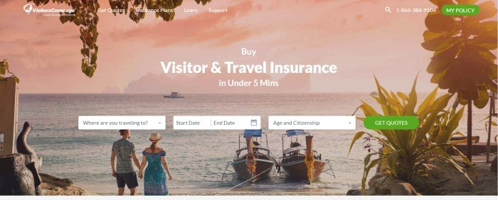 This screenshot of the home page for Visitors Coverage has a photo of a pink sky above an ocean, with people along the beach looking out to sea, watching a fishing boat, behind white text introducing visitor and travel insurance and white search windows with a green