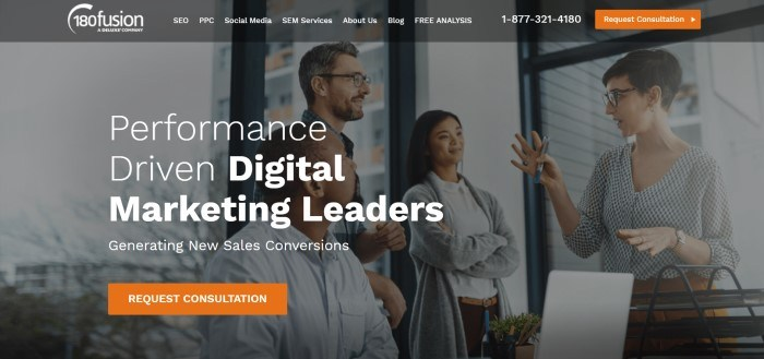 This image of the screenshot of the home page for 180 fusion includes a dark filtered photo of some businesspeople in a discussion near an office window, behind white lettering which reads 'Performance driven digital marketing leaders,' along with an orange call-to-action button.