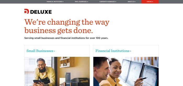 This screenshot of the home page for Deluxe has a white background with black and red text, along with a photo of a man at a desk in a small office and a link to the small business section of the website, next to a photo of a smiling man and woman looking at a row of computer screens with graphs on them and a link to the financial institutions section of the website.