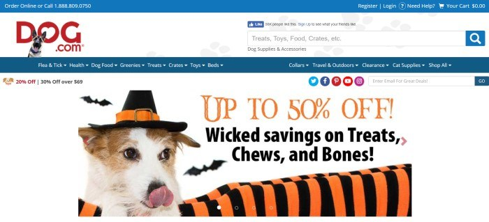This screenshot of the home page for Dog.com has a white background with blue elements, a photo of a dog in a witch costume, and a 50%-off Halloween sale advertisement.