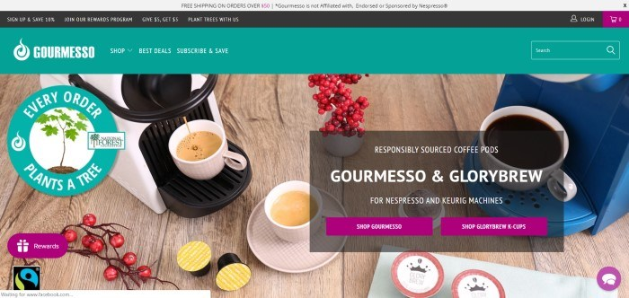 This screenshot of the home page for Gourmesso has a photo of espresso dripping into a white cup on an expresso machine near a vase of red berried branches on a rustic table.