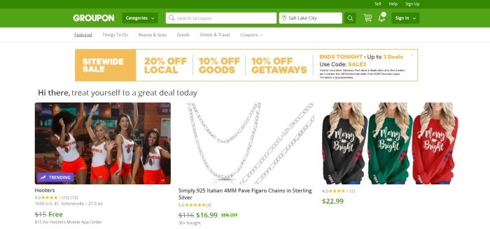 This screenshot of the home page for Groupon has a green header and search bar above a white background with several photos of deals on Groupon, including a restaurant, chain necklaces, Christmas sweatshirts and an orange and white sitewide sale advertisement.
