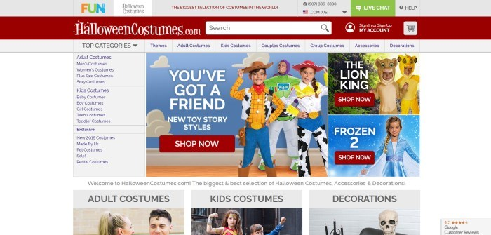 This screenshot of the home page for Halloween Costumes.com has a white background with red and blue elements, along with a photo of a family in Toy Story costumes in front of a background of a blue sky with white clouds.