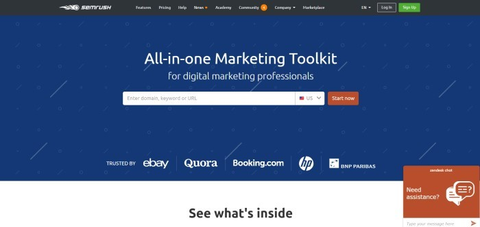 This screenshot of the home page for SEMrush shows a dark blue background with white circles and diagonal slashes behind white text announcing SEMrush as an all-in-one marketing toolkit and a rust-colored 'Start now' call-to-action button.