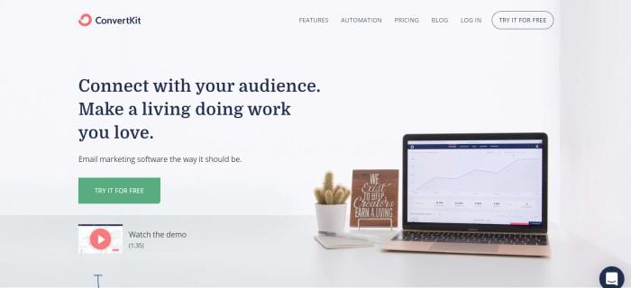 """This screenshot of the home page for ConvertKit has a light blue background with black wording that reads """"Connect with your audience,"""" next to a photo of an open laptop with a graph on the screen and a potted cactus, as well as an announcement for making a living doing work you love and a green call-to-action button."""