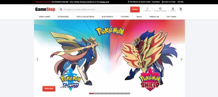 This screenshot of the home page for GameStop has a light gray background with the GameStop logo in black and red above two screen images of the Pokemon characters Sword and Shield in backgrounds of red and blue, along with a red call-to-action button.