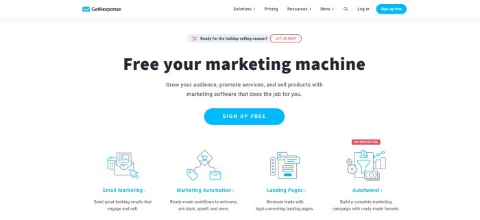 """This screenshot of the home page for GetResponse has a white and light gray background with blue elements and black text, including words that read """"Free your marketing machine"""" and two blue call-to-action buttons for signing up for free, as well as a row of blue and black outlined icons representing email marketing, marketing automation, landing pages, and autofunnels."""