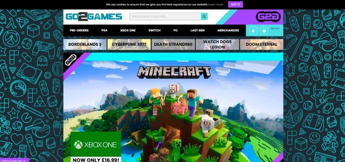 This screenshot of the home page for Go2Gameshas a large image of a screenshot from Minecraft, including characters like Alex, Steve, a pig, a sheep, a dog, a creeper, a zombie, and other characters on a high mountain, in front of an aqua and black background.